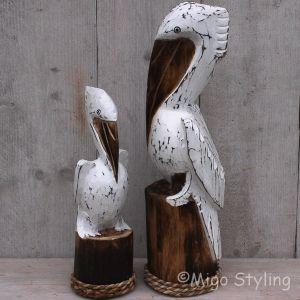 Pelikanen houtsnijwerk
